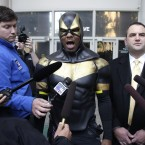 Ben Fodor/Phoenix Jones outside court yesterday, announcing his intention to continue his patrols. (AP Photo/Ted S. Warren/PA Images)