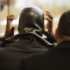 Fodor dons his Phoenix Jones mask at a Seattle court yesterday. (AP Photo/Ted S. Warren/PA Images)