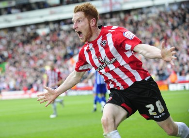 Stephen Quinn celebrates after opening the scoring for Sheffield United against Sheffield Wednesday yesterday. The match finished 2-2.