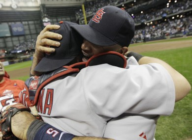 St. Louis Cardinals' Albert Pujols, right, hugs Yadier Molina after they beat the Milwaukee Brewers to win the National League championship series.