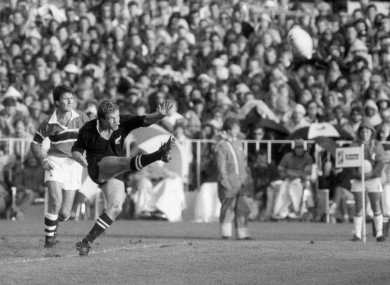 Grant Fox kicks a penalty for New Zealand as Australian referee Kerry Fitzgerald looks on.