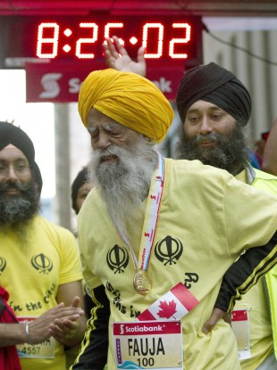 Fauja Singh grimaces after completing the Toronto Waterfront Marathon in over eight hours.