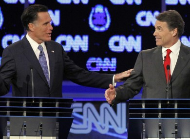Mitt Romney and Rick Perry share a moment in last night's debate.