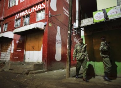Kenyan police guard the scene of today's grenade attack at a Nairobi nightclub.