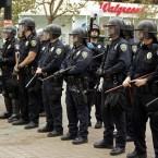 Oakland police officers in riot gear line Frank H Ogawa plaza during yesterday morning's eviction. (AP Photo/Ben Margot)