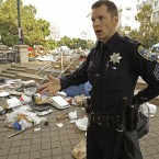 A police officer gestures at the site of yesterday morning's Occupy Oakland protest eviction. (AP Photo/Ben Margot)