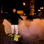 An Occupy Wall Street protester stands with a banner after police use tear gas to disperse a large crowd. (AP Photo/Darryl Bush)