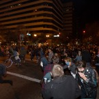 Protesters run from tear gas deployed by police in Oakland last night. (AP Photo/Darryl Bush)