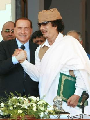Silvio Berlusconi with Muammar Gaddafi (File photo)