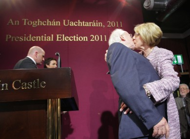 Michael D Higgins gets a kiss from his wife Sabina on stage at Dublin Castle before being announced as the new President of Ireland