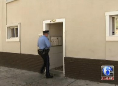 A police officer enters the building where the four were discovered.