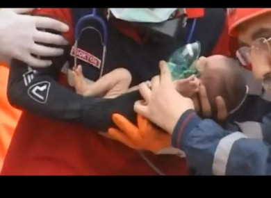 Miracle: two-week-old Azra Karaduman is pulled from the rubble