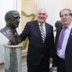 Bertie Ahern with former SDLP leader John Hume stand beside a bust of former President and Taoiseach Eamon De Valera at Aras an Uachtarain.