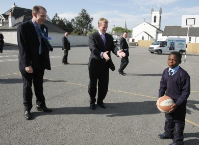 Mayor of Naas Darren Scully pictured with Fine Gael Leader Enda Kenny TD with school children in Kill National School in Kill County Kildare, on day two of the General Election 07.