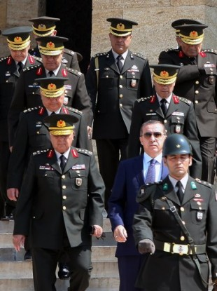 Prime Minister Recep Tayyip Erdogan, center, Gen. Necdet Ozel, Turkey's new Land Forces Commander and acting Chief of Staff, left, and top army generals