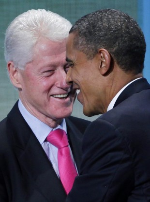 Former US President Bill Clinton and President Barack Obama embrace at the Clinton Glo