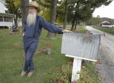 Sam Mullet, one of the seven men arrested today, pictured outside his Ohio home on 10 October.