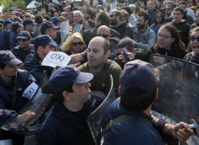 Anti-austerity protesters clash with riot police in Iraklio, Crete, on Friday.