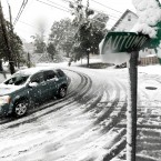 The snow-covered intersection of Autumn and Grove Streets in Lodi, New Jersey (AP Photo/Julio Cortez)