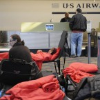Stranded passengers rest on cots a day after a storm at Bradley International Airport in Connecticut (AP Photo/Jessica Hill)