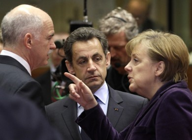 Papandreou with Sarkozy and Merkel in Brussels earlier this year