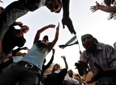 Protesters demonstrate against the Syrian government outside the Arab League HQ in Cairo on Wednesday.