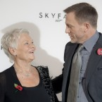 James Bond/Daniel Craig and Dame Judi Dench (who plays M) share a moment at the photocall for Skyfall. (AP Photo/Joel Ryan)
