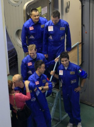Russia's Alexey Sitev kisses his wife after the group emerges from the Mars500 mission.