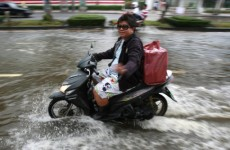 In pictures: More Bangkok residents urged to leave city as flooding worsens