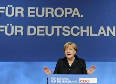 Angela Merkel gave her hour-long address to CDU delegates in front of a display reading: 'For Europe, for Germany'.