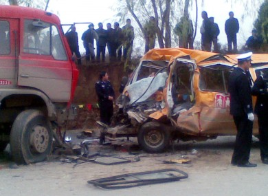 The school bus was destroyed in a collision with a truck in Yulinzi town.