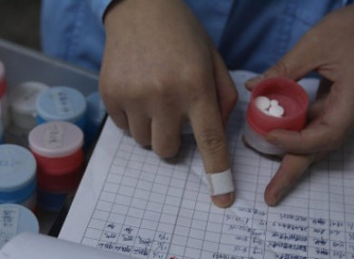 File photo of a nurse preparing medication for HIV patients.
