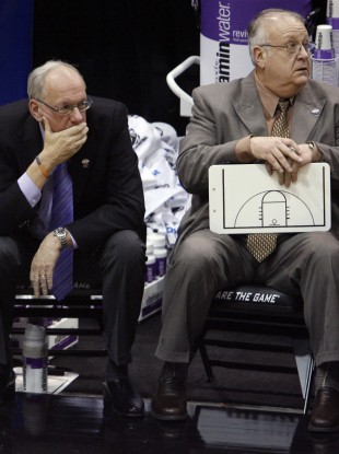 Bernie Fine, right, watches a game with Syracuse coach Jim Boeheim in 2010.