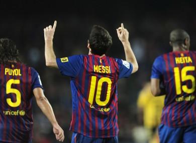 Messi celebrates scoring against Zaragoza.