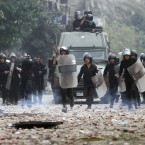 Egyptian riot police on the move during today's clashes with protesters in Tahrir Square. (AP Photo/Ahmed Ali/PA Images)