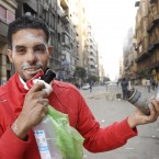 An Egyptian protester holds tear gas canisters in Cairo. (AP Photo/Mohammed Abu Zaid/PA Images)