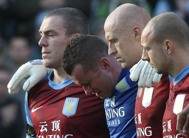 Shay Given and his Aston Villa teammates during the minute's silence for Gary Speed on Sunday. The inquest into his death opens today.