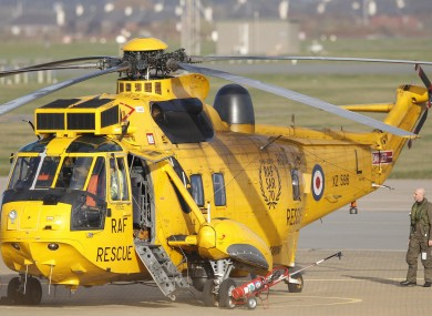 A Westland Sea King search and rescue helicopter sits on the ground at RAF Valley during an operation to rescue survivors from a ship which sank after being hit by an enormous wave in the Irish Sea.