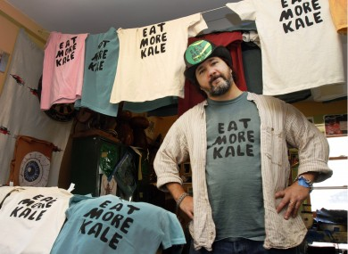 Bo Muller-Moore stands in his home studio in Montpelier, Vermont. His business is built around the term