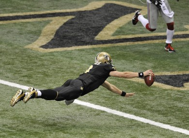 New Orleans Saints quarterback Drew Brees dives into the endzone to score a touchdown against the New York Giants last night. The Saints won the game 49-24.