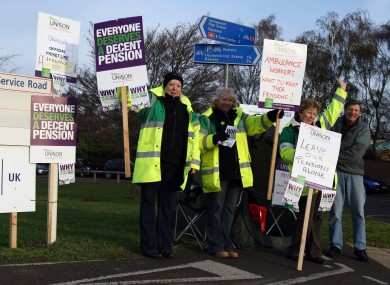 Workers from the East Anglian Ambulance Service picket an entrance to the Queen Elizabeth Hospital in Kings Lynn, Norfolk