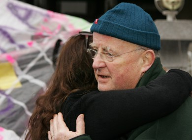 Christy Moore embraces an activist at the Occupy Dame St camp