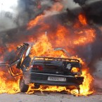 A burning car during a demonstration in Marrakech, Morocco in one of a string of nationwide protests calling for constitutional reform on 20 February, 2011. (AP Photo/Tarik Najmaoui/PA Images)