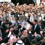 In this photo released by the Syrian official news agency SANA, Syrian President Bashar Assad, foreground right, waves to his supporters in Damascus, Syria on 30 March, 2011. Syria's president has blamed the wave of protests against his authoritarian rule on 'conspirators' - but he failed to offer any concessions to appease the extraordinary wave of dissent. (AP Photo/SANA/PA Images)