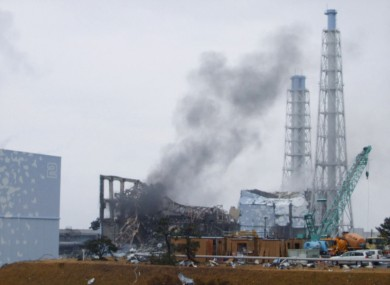 The smoking No. 3 reactor building (C) and buildings of reactors No. 2 (L, front) and No. 4 (R, back) of the quake-hit Fukushima Dai-ichi Nuclear Power Station