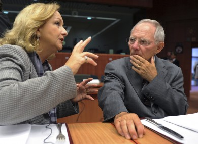 Wolfgang Schauble speaks with his Austrian counterpart Maria Fekter at an EU summit earlier this year.