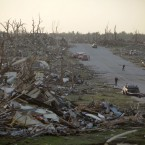 A residential neighbourhood in Joplin, Missouri, on 23 May, 2011 after it was levelled by a tornado that destroyed nearly 30 per cent of the town and cut a six-mile path through the city. (AP Photo/Tulsa World, Adam Wisneski/PA Images)