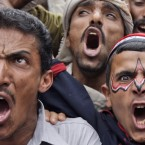 Yemeni anti-government protesters shout slogans during a demonstration demanding the resignation of Yemen's President Ali Abdullah Saleh, in Sanaa, Yemen in early May. (AP Photo/Hani Mohammed/PA Images)