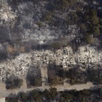 Aerial image taken on 7 September showing some of the hundreds of homes destroyed by wildfires in Texas. (AP Photo/Eric Gay/PA Images)