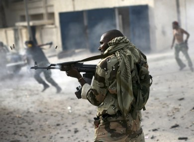 A Liben rebel fighter fires towards Gaddafi loyalists in Sirte, Libya on 19 October.